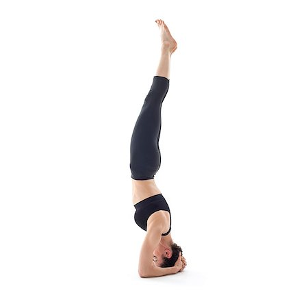fit people - Woman practicing yoga. She is doing a headstand. Stock Photo - Premium Royalty-Free, Code: 679-07607084