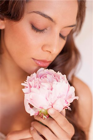 expressive - Woman smelling a flower. Stock Photo - Premium Royalty-Free, Code: 679-07607535