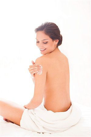 Woman applying body lotion. Stock Photo - Premium Royalty-Free, Code: 679-07607557