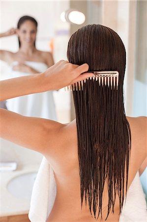 Woman brushing her hair. Stock Photo - Premium Royalty-Free, Code: 679-07607561