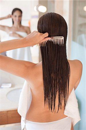Woman brushing her hair. Stock Photo - Premium Royalty-Free, Code: 679-07607563