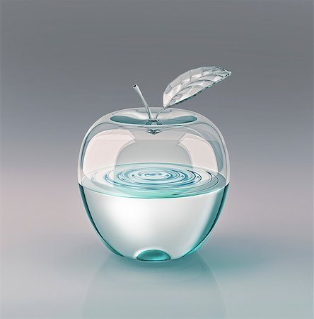 Water-filled glass apple, artwork. Stock Photo - Premium Royalty-Free, Code: 679-07607743