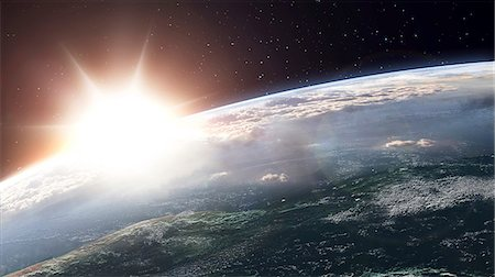 Artwork of a sun over planet earth. Stock Photo - Premium Royalty-Free, Code: 679-07607959