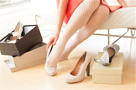 fashion - Woman trying on a pair of new shoes. Stock Photo - Premium Royalty-Free, Code: 679-07608000