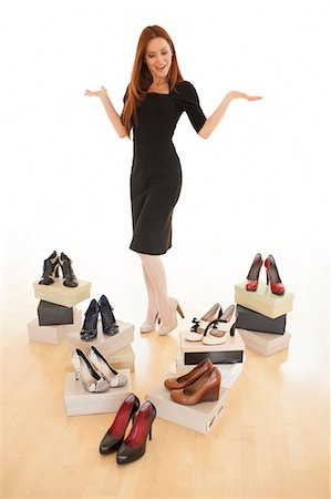 entry field - Woman with boxes of new shoes. Stock Photo - Premium Royalty-Free, Code: 679-07608002