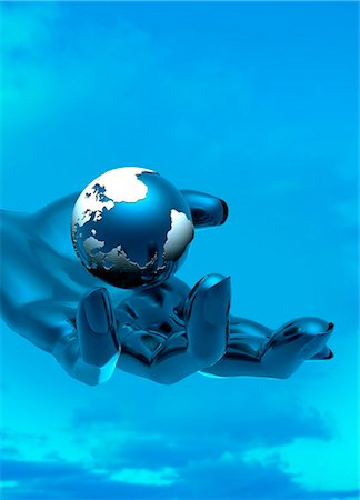 Artwork of a cyborg hand holding the globe. Stock Photo - Premium Royalty-Free, Code: 679-07608147