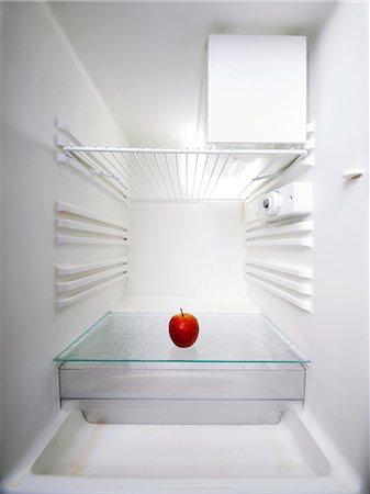 fridge - Red apple in an empty fridge. Stock Photo - Premium Royalty-Free, Code: 679-07608266