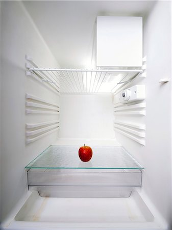 fridge - Red apple in an empty fridge. Stock Photo - Premium Royalty-Free, Code: 679-07608266
