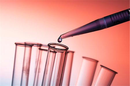 Pipette and drop of liquid with test tubes. Stock Photo - Premium Royalty-Free, Code: 679-07608262