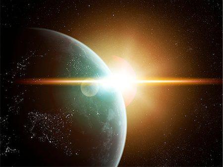 Earth and Sun, computer artwork. Stock Photo - Premium Royalty-Free, Code: 679-07603179