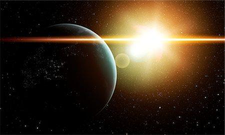 Earth and Sun, computer artwork. Stock Photo - Premium Royalty-Free, Code: 679-07603187