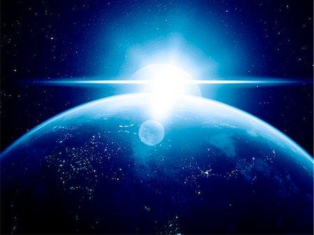 Earth and Sun, computer artwork. Stock Photo - Premium Royalty-Free, Code: 679-07603181