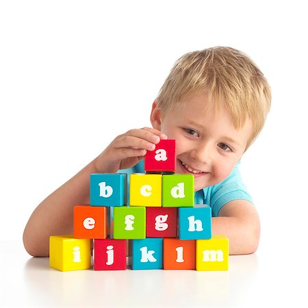Boy playing with alphabet blocks. Stock Photo - Premium Royalty-Free, Code: 679-07603473