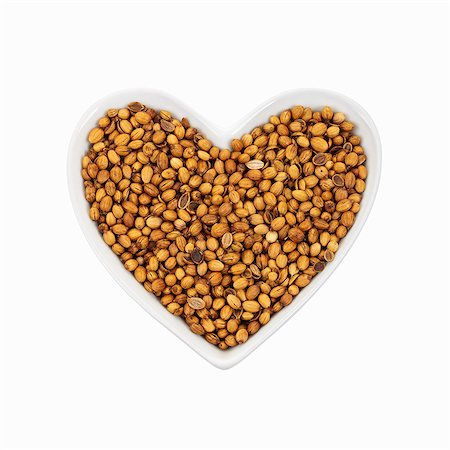Coriander seeds in a heart-shaped dish. Stock Photo - Premium Royalty-Free, Code: 679-07649550