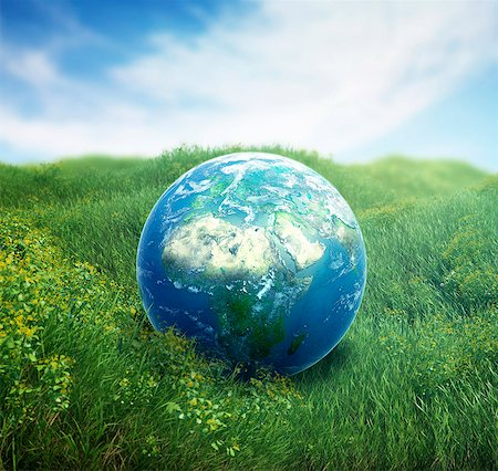 Planet earth on green grass, computer artwork. Stock Photo - Premium Royalty-Free, Code: 679-07732344