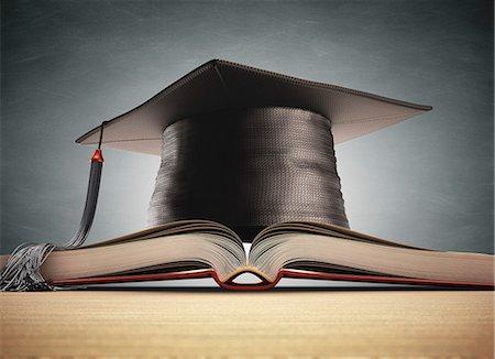 Graduation certificate and mortar board, computer artwork. Stock Photo - Premium Royalty-Free, Code: 679-07764735