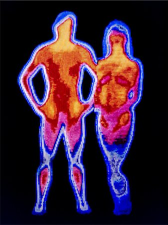 Couple. Thermogram of a naked man and woman. The colours show variation in temperature. The scale runs from white (warmest) through red, yellow, green and blue to purple (coldest). Thermography records the temperature of surfaces by detecting long-wavelength infrared radiation. Thermography is often used for breast screening, allergy detection and in vetenary use. Also for detecting suspected flu Stock Photo - Premium Royalty-Free, Code: 679-07765956