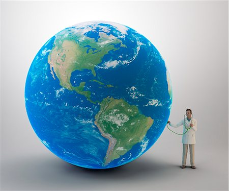 Doctor examining planet Earth, computer artwork. Stock Photo - Premium Royalty-Free, Code: 679-07846021