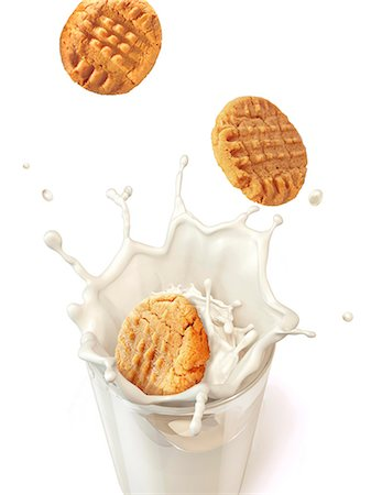 Biscuits splashing into milk, computer artwork. Stock Photo - Premium Royalty-Free, Code: 679-07846213