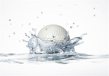 Golf ball splashing into water, computer artwork. Stock Photo - Premium Royalty-Free, Code: 679-07846248