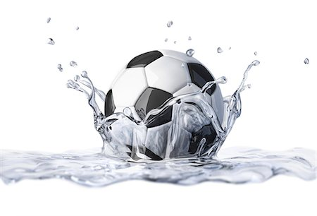 Football splashing into water, computer artwork. Stock Photo - Premium Royalty-Free, Code: 679-07846251