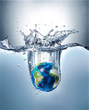 Planet earth splashing into water, computer artwork. Stock Photo - Premium Royalty-Free, Code: 679-07846278