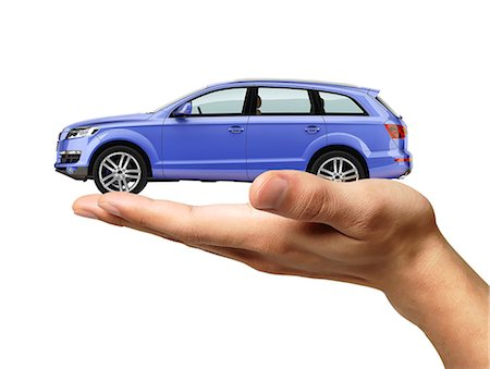 Person holding a car in hand, computer artwork. Stock Photo - Premium Royalty-Free, Code: 679-07846298