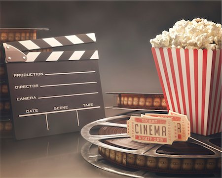 slate - Clapperboard, popcorn, cinema tickets and a movie reel, computer illustration. Stock Photo - Premium Royalty-Free, Code: 679-07962048
