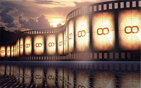 Old fashioned movie reel at sunset, conceptual illustration. Stock Photo - Premium Royalty-Free, Code: 679-07962055