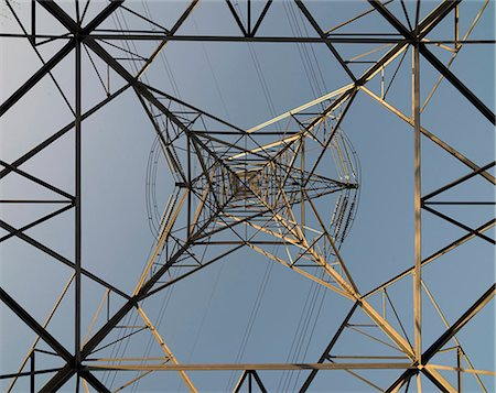 View of electricity pylon and power lines looking vertically upwards from ground level. Photographed in Wednesbury, West Midlands, UK Stock Photo - Premium Royalty-Free, Code: 679-08009669