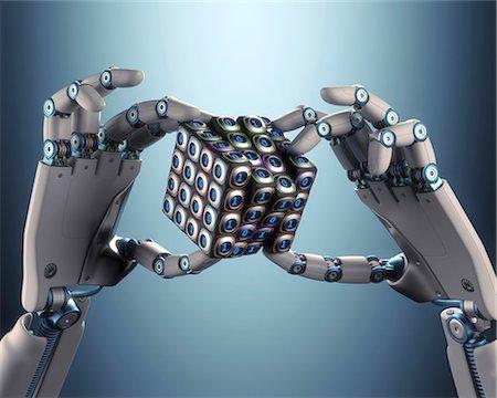 Robotic hand holding cube, illustration Stock Photo - Premium Royalty-Free, Code: 679-08027017