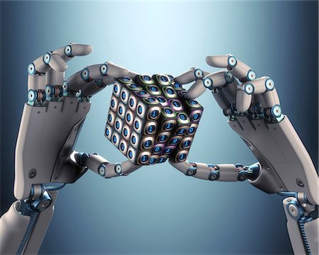 Robotic hand holding cube, illustration Stock Photo - Premium Royalty-Free, Code: 679-08027017