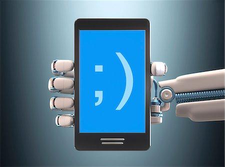 Robotic hand holding phone, illustration Stock Photo - Premium Royalty-Free, Code: 679-08027021