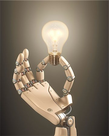 Robotic hand holding a light bulb Stock Photo - Premium Royalty-Free, Code: 679-08027037