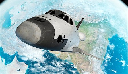 space - Space shuttle above the Earth, computer illustration. Stock Photo - Premium Royalty-Free, Code: 679-08121763