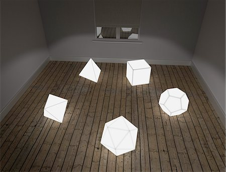 solid - Illuminated models of the five Platonic solids on floor of room in studio Stock Photo - Premium Royalty-Free, Code: 679-08221095