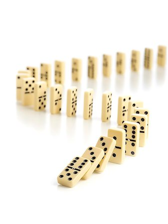 falling - Dominoes falling down against a white background. Stock Photo - Premium Royalty-Free, Code: 679-08425051