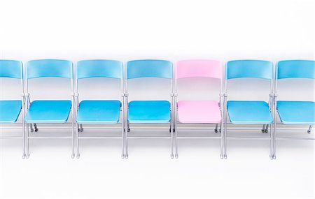 represented - One pink chair in a row of blue chairs. Stock Photo - Premium Royalty-Free, Code: 679-08718348