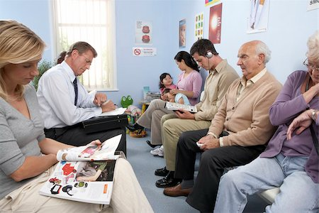 General practice waiting room filled with patients. Stock Photo - Premium Royalty-Free, Code: 679-02685651