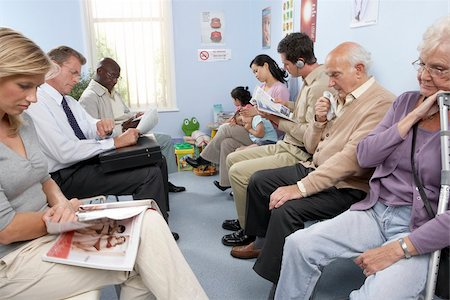 General practice waiting room filled with patients. Stock Photo - Premium Royalty-Free, Code: 679-02685652