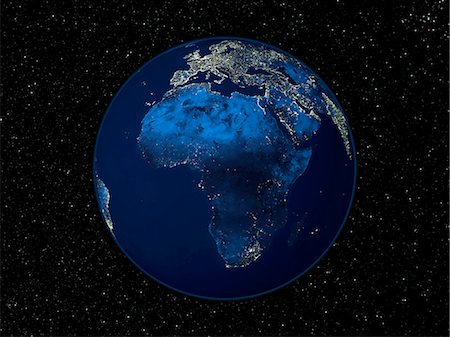 Africa at night. Satellite image of the Earth at night, set against a background of stars, centred on the continent of Africa. North is at top. City lights (yellow) show areas of dense population. Most of Africa is dark in comparison with the bright lights of the cities of Europe and the Middle East (across top). Rural and undeveloped areas in Africa include the vast Sahara desert in the north, tr Stock Photo - Premium Royalty-Free, Code: 679-02682137