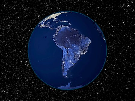 South America at night. Satellite image of the Earth at night, set against a background of stars, centred on the continent of South America. North is at top. City lights (yellow) show areas of dense population. The highest concentrations of population are on the south-eastern coast, in cities such as Rio de Janeiro, Sao Paulo, and Buenos Aires. Large cities are also seen on the north-western coast Stock Photo - Premium Royalty-Free, Code: 679-02682142
