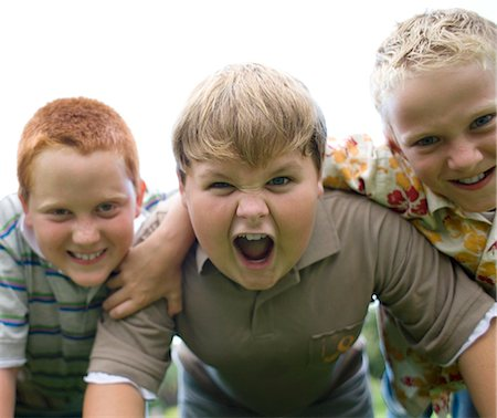 Friendship. Group of boys playing on their hands and knees. Stock Photo - Premium Royalty-Free, Code: 679-02682572