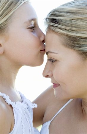 Mother and daughter. Girl kissing her mother. Stock Photo - Premium Royalty-Free, Code: 679-02683490