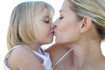 Mother and daughter kissing. Stock Photo - Premium Royalty-Free, Code: 679-02683492