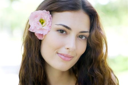Woman wearing a flower in her hair. Stock Photo - Premium Royalty-Free, Code: 679-02683810