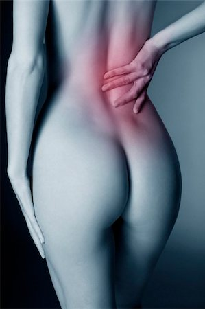 female nude hip - Lower back pain Stock Photo - Premium Royalty-Free, Code: 679-02995194