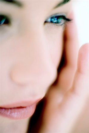 Woman touching her face Stock Photo - Premium Royalty-Free, Code: 679-02995584