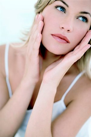 Woman touching her face Stock Photo - Premium Royalty-Free, Code: 679-02995585