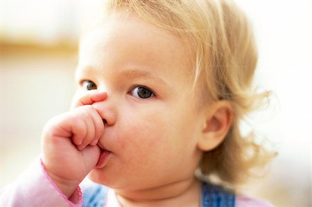 sucking - Young girl sucking her thumb Stock Photo - Premium Royalty-Free, Code: 679-02995773
